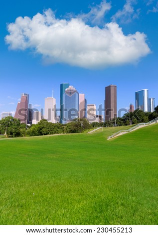 Houston skyline sunny day with park turf under blue sky at Texas USA - stock photo