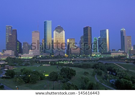 Houston skyline with Memorial Park in foreground at dusk in Texas - stock photo