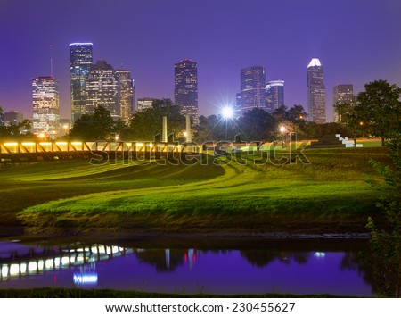 Houston sunset skyline from Memorial park at Texas US - stock photo