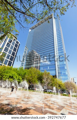 HOUSTON, TEXAS - March 2016: Street scene in Houston Downtown in Greenway Plaza park on sunny day on March 2016 in Houston, Texas. Kids playing at water fountains playground. - stock photo