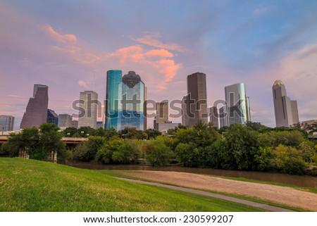 Houston, Texas  skyline at sunset twilight from park lawn - stock photo