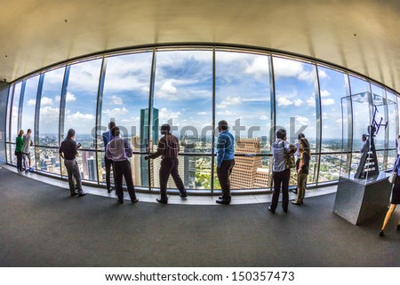HOUSTON, USA - JULY 11: people enjoy the scenic view from JPMorgan Chase tower on July 11, 2013 in Houston, USA. The visitor platform is open to public during office hours without entrance fee. - stock photo