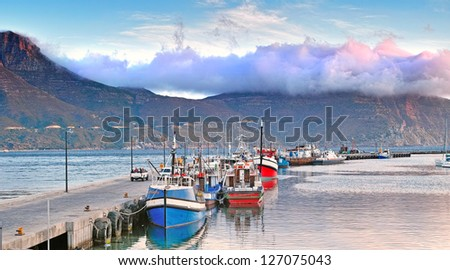 Hout Bay harbour in summertime - close to Cape Town, South Africa - stock photo