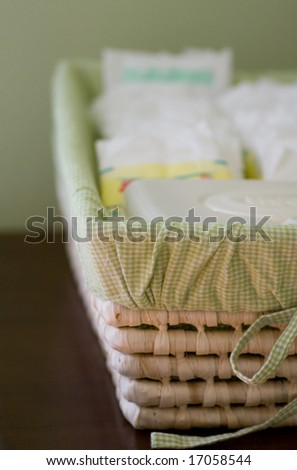 how a basket of diapers looks after a week with a newborn (and no sleep!) - stock photo