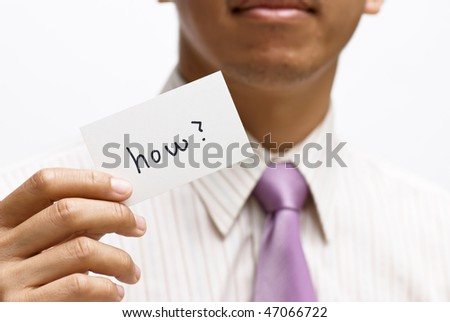 How card holding by businessman on white background. - stock photo