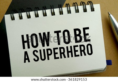 How to be a superhero memo written on a notebook with pen - stock photo