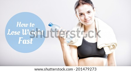 How to lose weight fast, beautiful woman with bottle and towel - stock photo