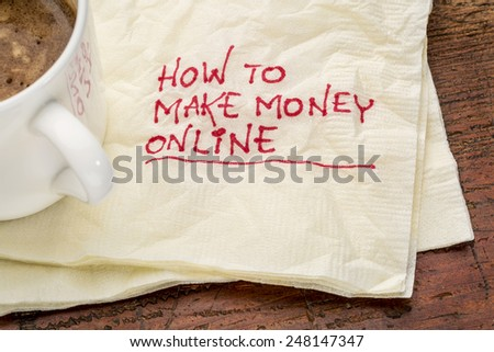 How to make money online - handwriting on a napkin with a cup of coffee - stock photo