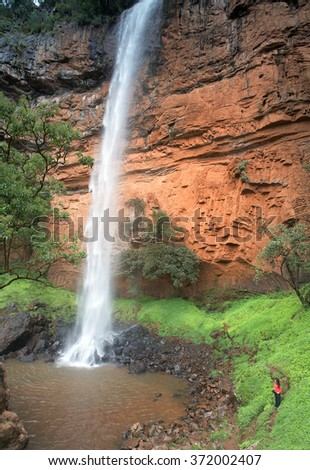 Howick Falls,high and scenic waterfall on Umgeni River with small lagoon, surrounded by a dense forest canopy, Howick, KwaZulu-Natal Province, South Africa. - stock photo