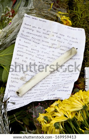 Howick, KwaZulu-Natal, South Africa - 15 December 2013: A letter to the recently deceased Nelson Mandela lies at the site where the former political activist was captured in 1962. - stock photo