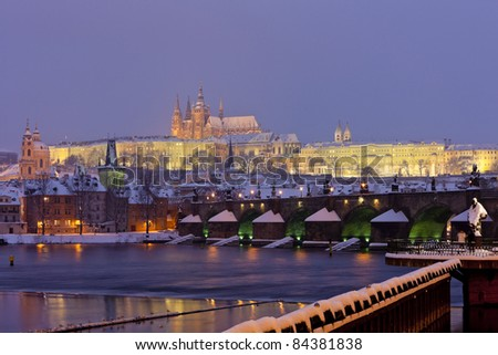 Hradcany with Charles bridge in winter, Prague, Czech Republic - stock photo