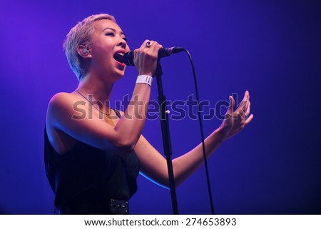 HRADEC KRALOVE - JULY 5: Singer Alisa Xayalith of The Naked and Famous during performance at festival Rock for People in Hradec Kralove, Czech republic, July 5, 2014. - stock photo