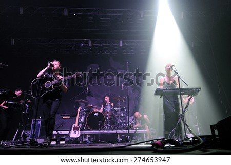 HRADEC KRALOVE - JULY 5: Thom Powers (L), Jesse Wood (C) and Alisa Xayalith (R) of The Naked and Famous during performance at festival Rock for People in Hradec Kralove, Czech republic, July 5, 2014. - stock photo