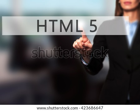 HTML 5 - Businesswoman hand pressing button on touch screen interface. Business, technology, internet concept. Stock Photo - stock photo