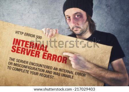 Http Error 500, Internal Server error page concept. Man holding banner with error message - stock photo