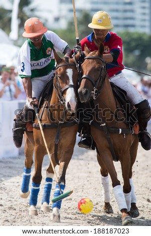 HUA HIN, THAILAND - APRIL 19: Hong Kong Polo Team (R) plays against Macau Polo Team (L) during 2014 Beach Polo Asia Championship on April 19 2014 in Hua Hin, Thailand. France Polo Team wins 8-4. - stock photo