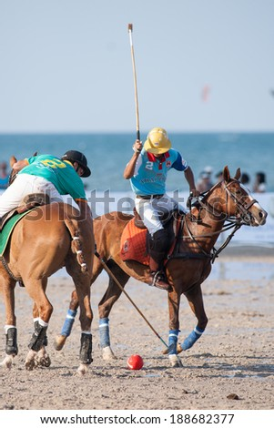HUA HIN, THAILAND - APRIL 21: Thai Polo Team (R) plays against Macau Polo Team (L) during 2013 Beach Polo Asia Championship on April 21 2013 in Hua Hin, Thailand. Thai Polo Team wins 5-2. - stock photo