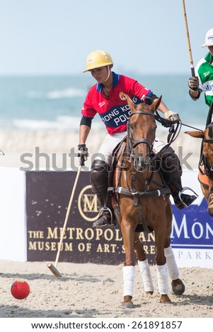 HUA HIN, THAILAND - APRIL 19: Unidentified player (L) of Hong Kong Polo Team in action during 2014 Beach Polo Asia Championship on April 19 2014 in Hua Hin, Thailand. - stock photo