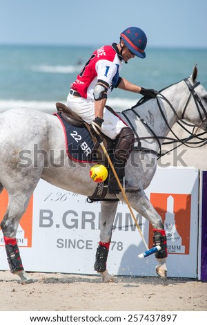 HUA HIN, THAILAND - APRIL 19: Unidentified player of France Polo Team in action during 2014 Beach Polo Asia Championship on April 19 2014 in Hua Hin, Thailand. France Polo Team wins 2-1. - stock photo