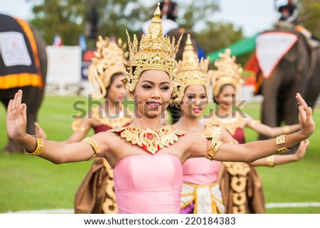HUA HIN, THAILAND - AUGUST 28: Unidentified thai dancers dancing.  Elephant polo games during the 2013 King 's Cup Elephant Polo match on August 28, 2013 at Suriyothai Camp in Hua Hin, Thailand. - stock photo