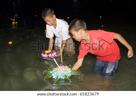 HUA HIN, THAILAND - NOVEMBER 21: Thai people float on water a small rafts (Krathong) to celebrate the Loy Krathong festival. November 21, 2010 Hua Hin, Thailand. - stock photo