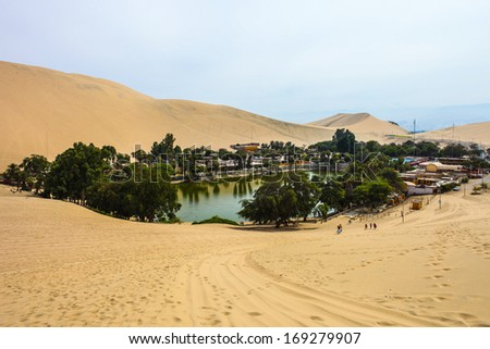 Huacachina oasis among sand dunes in Peru desert near Ica. - stock photo
