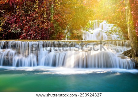 Huay Mae Khamin waterfall in deep forest with sunlight, Thailand  - stock photo