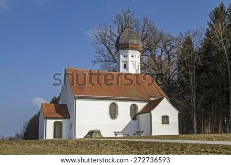 Hub chapel - idyllic little church near the Upper Bavarian town of Penzberg - stock photo