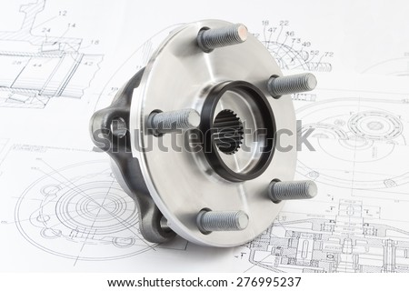 hub with bearing and ABS sensor on the background of drawings and plans - stock photo