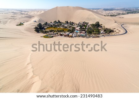 Hucachina oasis and sand dunes near Ica, Peru - stock photo