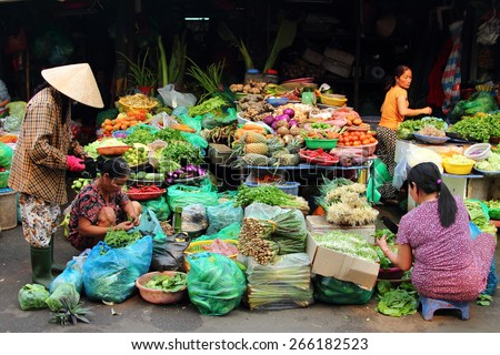 HUE, VIETNAM - MARCH 14, 2015: Vietnamese people buying and selling vegetables at Dong Ba market in Hue, Vietnam. - stock photo