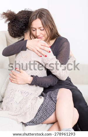 hug between girlfriends - stock photo