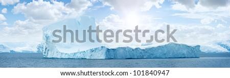 Huge antarctic ice island in atlantic ocean. Sunny day. Iceberg. - stock photo
