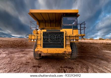 Huge auto-dump yellow mining truck - stock photo