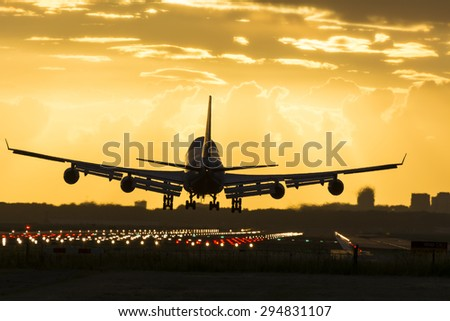 Huge Boeing 747 is landing on the runway. - stock photo