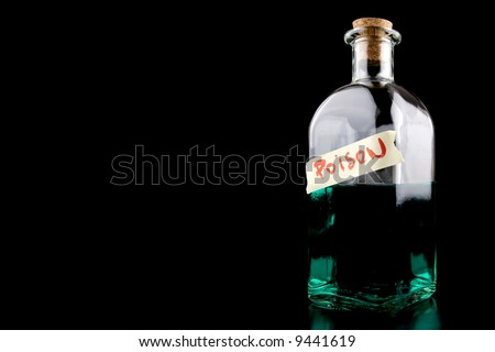 huge bottle with green poison on black - stock photo
