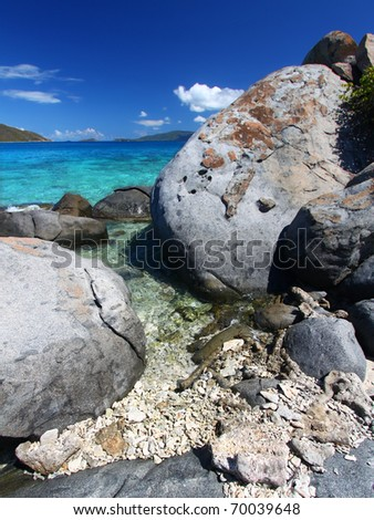 Huge boulders dot the coastline of the British Virgin Islands - stock photo