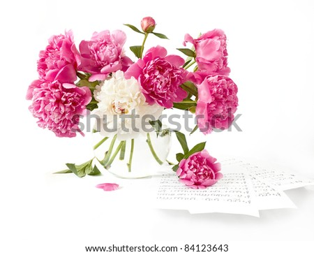Huge bunch of pink and white peonies in vase isolated on white - stock photo
