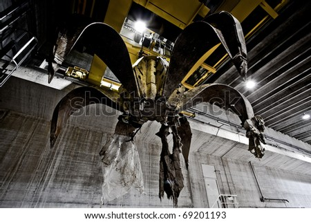 Huge claw for garbage - stock photo