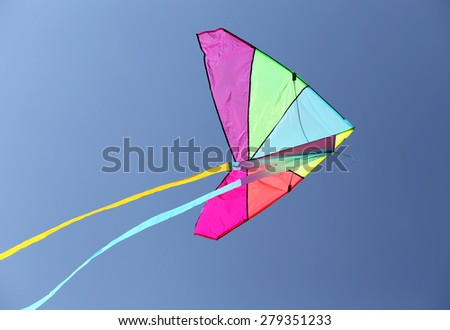huge colorful kite flying high in the sky blue - stock photo