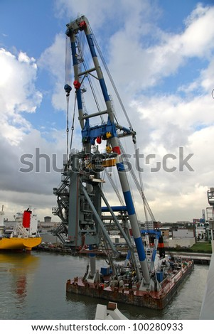 Huge crane barge doing marine heavy lift installation works in the Port of Rotterdam. - stock photo
