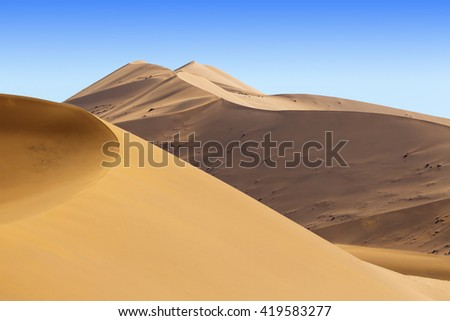 Huge dunes of the desert. Growth of deserts on Earth. Phenomenon of global warming and climate change of the planet. - stock photo