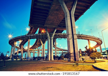 Huge elevated crossroad (Bhumibol bridge) in Bangkok, Thailand  - stock photo