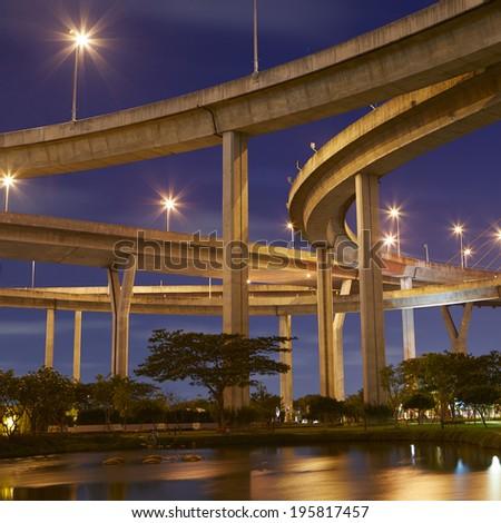 Huge elevated crossroad (Bhumibol bridge) in Bangkok, Thailand  - stock photo