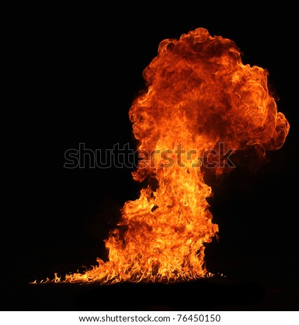 Huge fire flame isolated on black background - stock photo