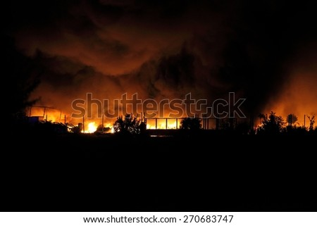 Huge fire spreading over buildings - stock photo