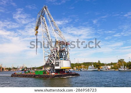 Huge floating crane at work in port of Gdynia, Poland. - stock photo