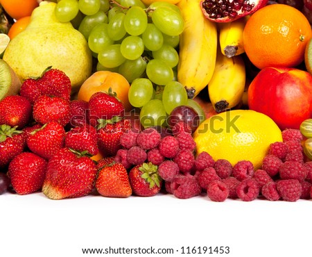 Huge group of fresh fruits isolated on a white background. Shot in a studio - stock photo