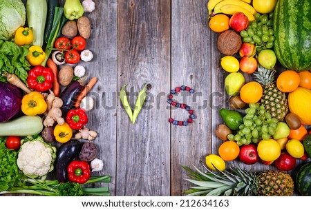 Huge group of fresh vegetables and fruit on wooden background - Vegetables VS Fruit - High quality studio shot - stock photo