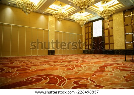 Huge Hall interior with red carpet and ceiling with lights in Hotel - stock photo